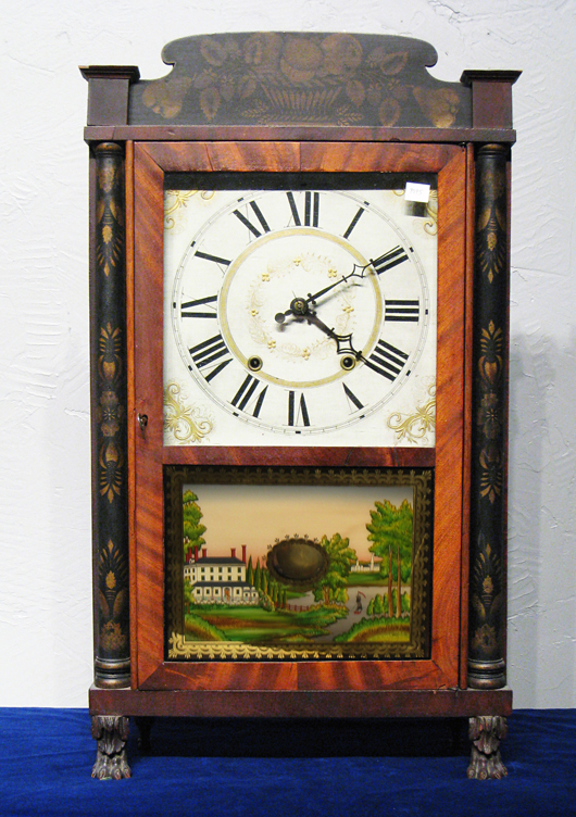 The original stencil decoration and reverse-painted glass remain intact on this circa-1830 American shelf clock. With carved paw feet and a wooden geared mechanism, it sold recently at auction for $574. Image courtesy of Gordon S. Converse & Co.