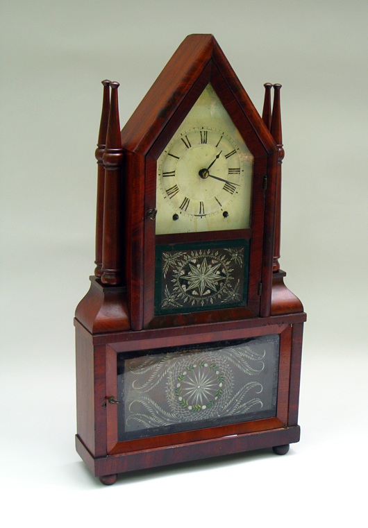 The reverse-painted glasses are original to this rare candlestick shelf clock, which has an ingenious 'wagon-spring' mechanism. It sold for $1,840. Image courtesy of Gordon S. Converse & Co.