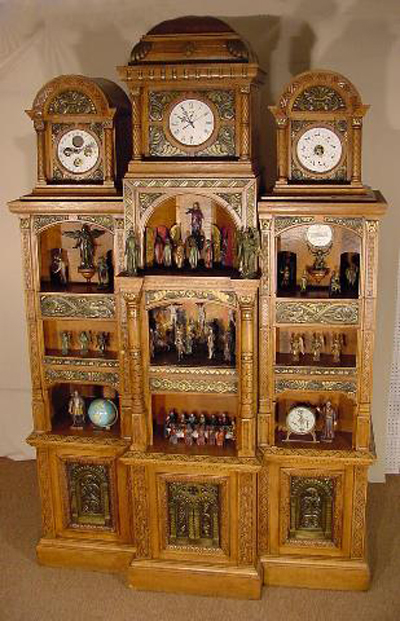 Stages of Christ's life, religious figures, Greek gods and Christopher Columbus are all depicted in this rare animated Black Forest astronomical clock in a golden oak case. Tom Harris sold this extraordinary clock at auction for $50,850. Image courtesy of Tom Harris Auctions.