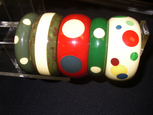 Original Bakelite bangles with newly added Bakelite polka dots. Image courtesy Florida Antique Shows/Puchstein Promotions.
