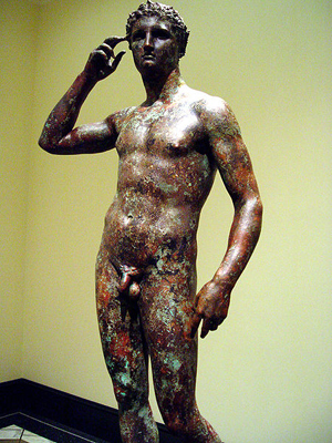 Victorious Youth, also known as the Getty Bronze, from the Hellenistic Period and depicting an athlete crowning himself. Photo taken 2-12-2006 by 3dnatureguy. Image appears courtesy of the photographer through Creative Commons GNU Free Documentation license.