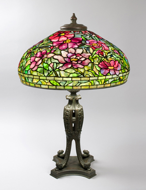 Macklowe Gallery brought this Peony table lamp by Tiffany Studios to the Winter Antiques Show. The 22-inch leaded glass shade sits atop a patinated bronze '9th Century' base. Image courtesy of the Winter Antiques Show