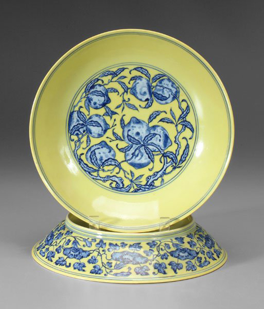 These Imperial bowls are slightly different. One is 2 inches by 10 5/8 inches, the other 2 1/8 inches by 10 1/2 inches. They are decorated front and back and have underglaze blue seal marks for Qianlong (1736-1795). The bowls sold for $97,750. Image courtesy Brunk Auctions.