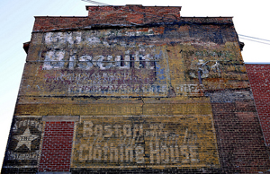 Several advertisements have survived on this building in downtown Schenectady, N.Y. You can see a Uneeda Biscuit ad at the top; the Boston One Price Clothing House at the bottom, and Seeley's 'The Star' Restaurant, an 1890's eatery, at far left. Photo by Chuck Miller.