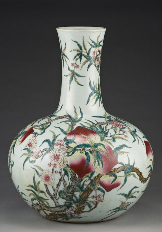 The nine peaches on a tree, the symbol of longevity, decorate this 20 1/4-inch-high Chinese Qing Famille Rose porcelain Tianqiu vase, which dates to the 19th century. It has a $8,000-$12,000 estimate. Image courtesy Dallas Auction Gallery.