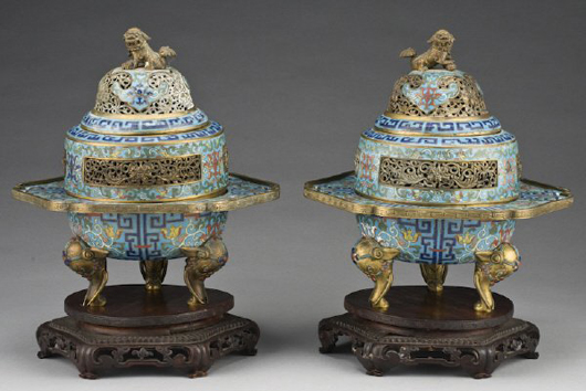 These Qing cloisonné tripod censers raised hardwood stands are 11 1/2 inches high. Dating to the late 18th century, the pair has an $8,000-$10,000 estimate. Image courtesy Dallas Auction Gallery.