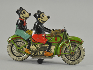 Circa-1932 Tippco (Germany) lithographed-tin clockwork motorcycle, 9¼ inches long with desirable toothy, five-fingered depictions of Mickey and Minnie Mouse, $23,000-$28,000. Image courtesy Bertoia Auctions.