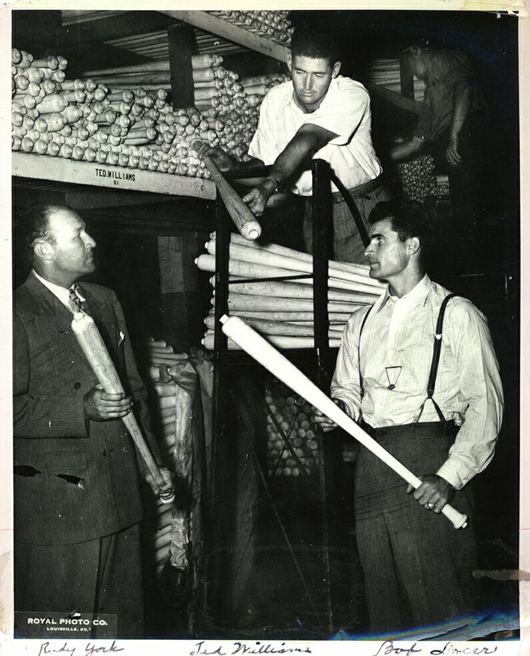 Ted Williams is pictured selecting Louisville Slugger bats at the factory. With him are Rudy York (left) and Bobby Doerr (right). The photo was likely taken in 1946-47 when the three were Boston Red Sox teammates. They combined for 1,021 home runs over their careers. Image courtesy Louisville Slugger Museum & Factory.