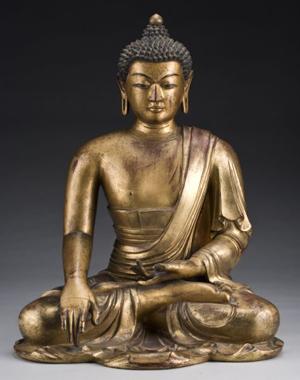 Chinese Ming or Qing gilt wood Shakyamuni Buddha, 25 inches high, circa 17th-18th century, $55,125. Image courtesy Dallas Auction Gallery.