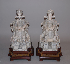 Foo dogs accompany a pair carved ivory statues of an emperor and empress. Exquisitely detailed throughout, the sculptures have a $10,000-$15,000. Image courtesy of Bill Hood & Sons Art & Antique Auctions.