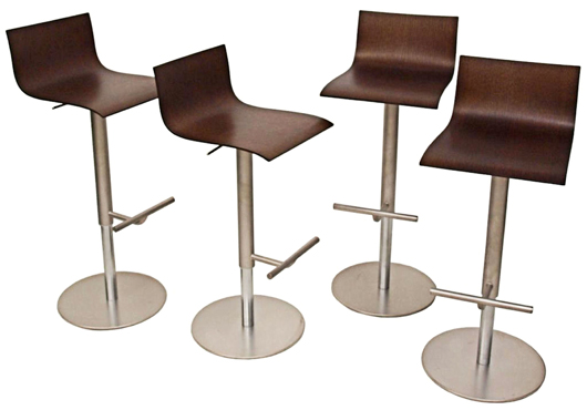 """Set of four """"thin"""" barstools designed by Karri Monni for La Palma, each with a molded swivel seat and gas-spring mechanism to adjust height. Sandblasted stainless steel with zinc-plated stainless steel bases. Estimate $1,500-$2,500. Image courtesy of Austin Auction Gallery."""