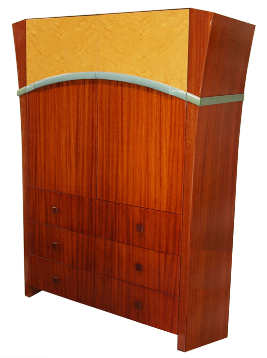 Art Deco-style, 60-inch-tall custom-made television cabinet designed by Dakota Jackson. Circa 1985, cherry-finished mahogany with the upper sections of the two doors finished in bird's-eye maple, accented with eau de nil trim. Interior fitted with mahogany pull-out TV tray. Estimate $3,000-$5,000. Image courtesy of Austin Auction Gallery.