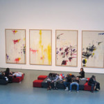 """People """"collapsed"""" at the Museum of Modern Art, New York, in front of the Cy Twombly series of paintings titled The Four Seasons: Spring, Summer, Autumn and Winter, 1993-94. Photo by Allie of Valence, France. Courtesy Wikipedia."""