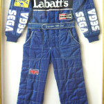 Retired British racing driver Damon Hill's name is sewn on the belt of this racing suit. Hill won the Formula One World Championship in 1996. Image courtesy Aurora.