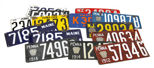 More than a dozen early porcelain enamel license plates will be sold at Stephenson's auction.