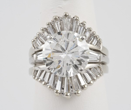 The round, brilliant-cut diamond at the center of this platinum and 14K gold ring weights 5.09 carats. It carries an $11,000-$16,000 estimate. Image courtesy Dallas Auction Gallery.