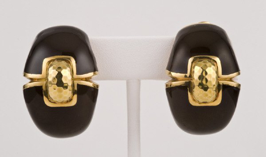These 18K gold black enamel earrings are stamped 'Webb 18K.' Designed by David Webb, the pair has a $4,000-$6,000 estimate. Image courtesy Dallas Auction Gallery.