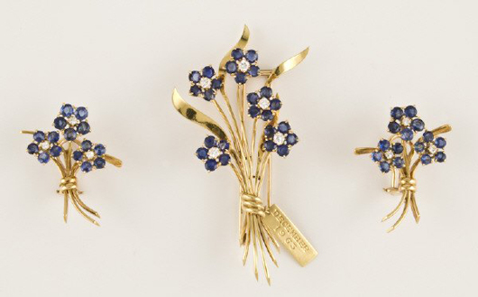 'Van Cleef and Arpels NY' is signed on this brooch and earrings set dated December 1963. Having 25 round, brilliant-cut sapphires and five round, brilliant-cut diamonds, the set has a $6,000-$9,000 estimate. Image courtesy Dallas Auction Gallery.