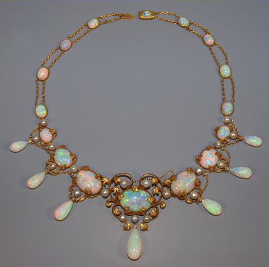 Important circa-1900 Art Nouveau necklace reputed to have once belonged to iconic American interior designer Elsie de Wolfe (a k a Lady Mendl, 1865-1950), comprised of more than 45 carats of cabochon, oval-cut and teardrop-shape Australian fire opals, 23 in all. Additional accents include 19 freshwater pearls and 52 single-cut diamonds. Retains original heart-shape leather case. Featured on Leigh and Leslie Keno's TV show Find! Estimate $60,000-$80,000. Image courtesy of Austin Auction Gallery.