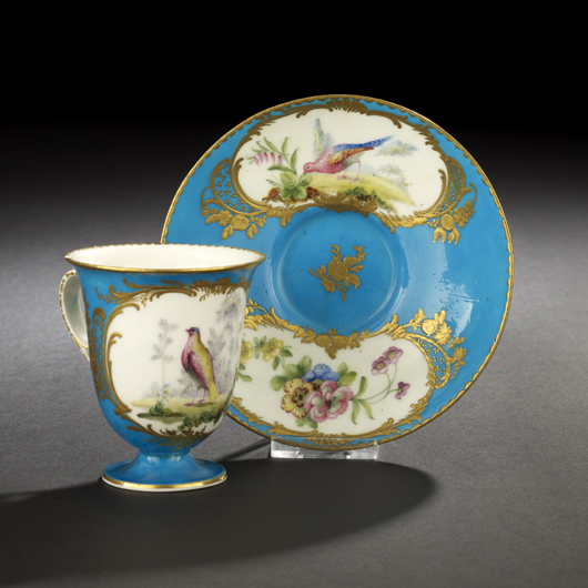 This elegant footed cup and saucer made at Sevres has a blue celeste ground and reserves painted with flowers and birds. The lot sold in New Orleans on March 27 for $420. Courtesy New Orleans Auction Galleries.