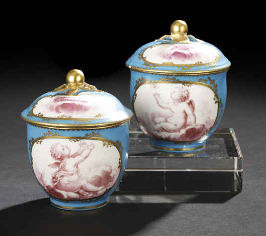 Small covered cups, referred to as pots a jus or pots a crème, were part of large Sevres dinner services. This 1768 pair with blue celeste ground and painted cherubs, also ex- Hodroff Collection, brought $1,020 at the New Orleans Auction Galleries sale in January. Courtesy New Orleans Auction Galleries.