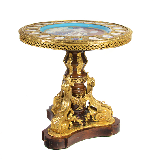 A circular table, or gueridon, ornamented with gilt metal attachments and inset Sevres-style portrait medallions, was sold by Leslie Hindman in January for $20,740. Courtesy Leslie Hindman Auctions, Chicago.