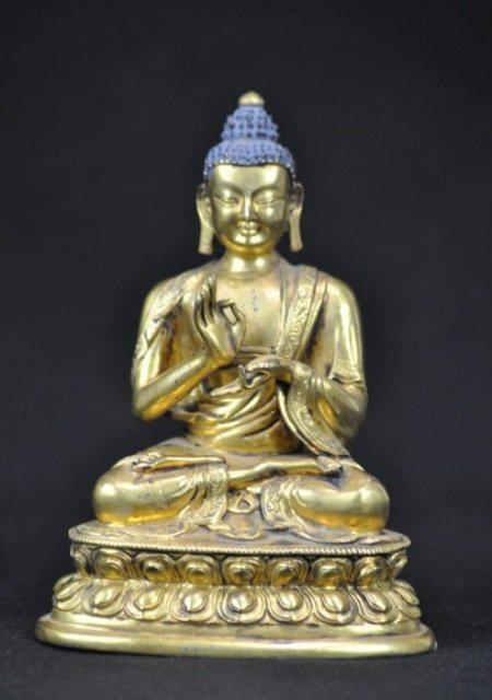 Gilt bronze figure of Buddha, Kangxi Period, 6 1/4 inches high, estimate: $5,000-$6,000. Image courtesy of Wichita Auction Gallery.