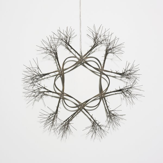 Ruth Asawa created this untitled (Snowflake) out of copper wire in 1955. It is 23 inches in diameter and has a $30,000-$40,000 estimate. Image courtesy of Wright.