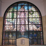 Designed by artist Grant Wood, the stained glass window is dedicated in memory of the men and women who gave their lives in defense of our country. Image courtesy of Glass Heritage, llc.