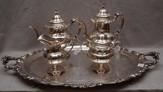 Weighing 98 troy ounces, this sterling silver Grand Baroque four-piece tea set with a silver-plated tray has a $3,500-$4,000 estimate. Image courtesy of Bill Hood & Sons Art & Antiques Auctions.