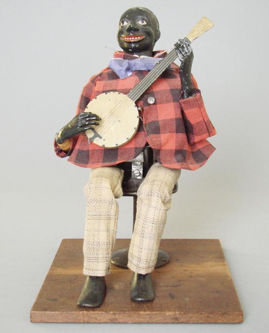 1876 Secor cloth-dressed clockwork Banjo Player, estimate $18,000-$25,000. RSL Auction Co. image.