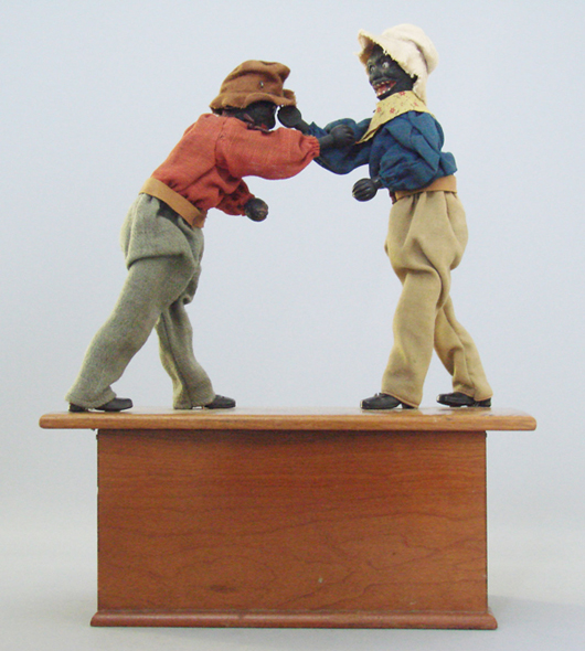 Circa-1885 Ives, Blakeslee clockwork toy known as the Boxers, or Sparring Pugilists, estimate $9,000-$12,000. RSL Auction Co. image.