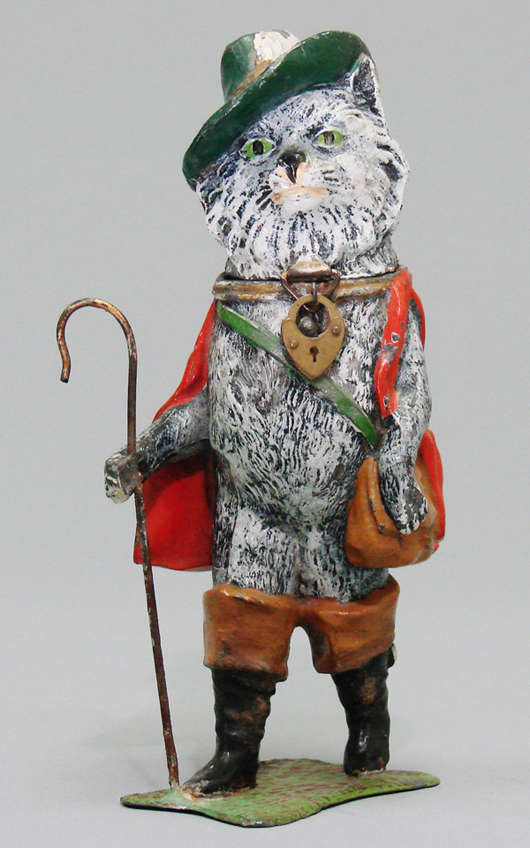 German painted-spelter Puss 'N' Boots with Staff bank, 7½ inches tall, one of only two known examples, estimate $6,500-$8,500. RSL Auction Co. image.