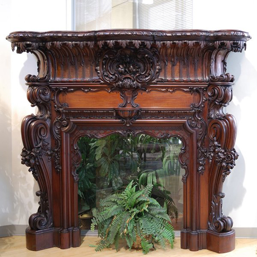 Bidding is expected to reach $4,000-$5,000 on this exquisitely carved solid mahogany fireplace mantel. It stands 72 inches high, 81 1/2 inches wide and 22 inches deep. Image courtesy of Morton Kuehnert Auctioneers & Appraisers.