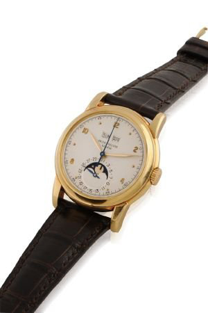 Extremely fine and equally rare, this early 1950s Patek Philippe, Ref. 2497, men's wristwatch has phases of the moon and perpetual calendar features. In like-new condition, it carries a $203,000-$240,000 estimate. Image courtesy of Patrizzi & Co. Auctioneers.