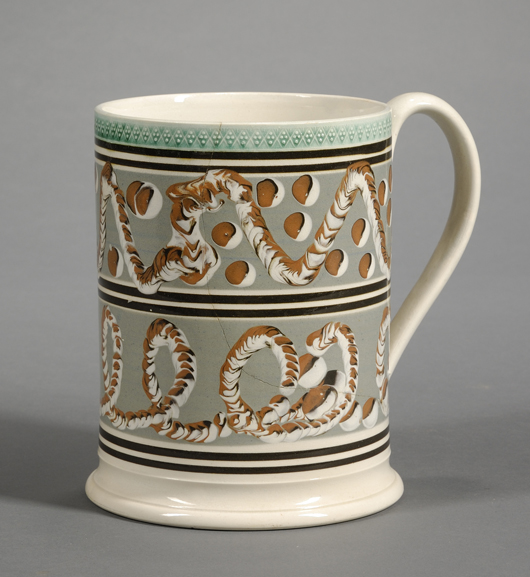 """This large 2-quart mug features two designs popular with collectors: circular cat's-eyes and looping """"earthworm"""" trails. In spite of a crack, the boldly decorated piece sold for $2,844. Image courtesy Skinner Inc."""