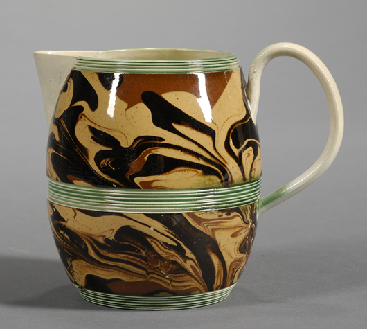 A small late 18th-century jug alternates marbled panels with green-painted reeded bands:  $2,370. Image courtesy Skinner Inc.