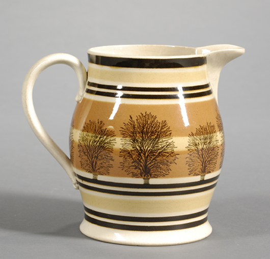Dark branching patterns resembling trees or seaweed are the classic decoration on mocha ware. This 6-inch jug sold for $1,067. Image courtesy Skinner Inc.