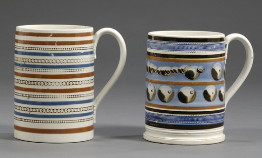 A lot of two banded quart mugs, one with cat's-eye decoration, brought $1,541 in a March sale of American Furniture and Decorative Arts at Skinner's. Image courtesy Skinner Inc.