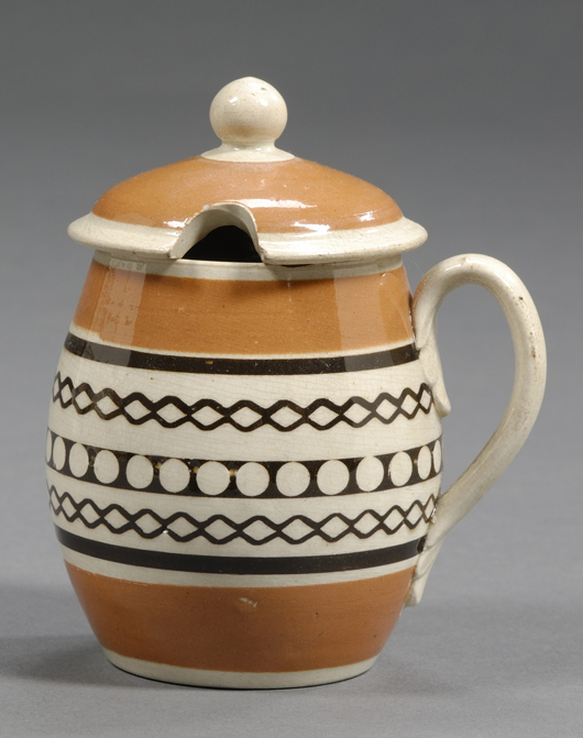 Mustard was an essential condiment on English tables in the 19th century. Less than 4 inches high, this small covered pot is ringed with geometric bands: $474. Image courtesy Skinner Inc.