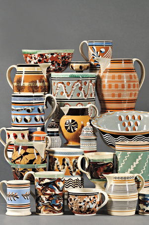 Colored slips, applied in a variety of ingenious techniques, produce the abstract patterns on the English pottery called mocha or dipped ware. Image courtesy Skinner Inc.