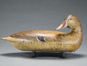 Antique duck decoy carved by Robert Elliston and purchased in April by former Illinois Governor Jim Thompson for $100,625. Image courtesy of Guyette and Schmidt, Inc., the company that conducted the auction.