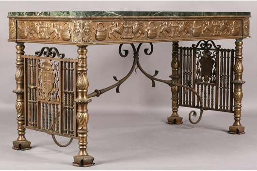 This Oscar Bach conservatory table is decorated with a frieze of lions and castles and supported by bronze legs with acanthus leaf detailing. It sold for $12,000, including premium, at the April 24 garden sale. Image courtesy Kamelot.