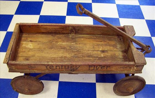 The Century Flyer wagon is 35 inches long and 15 1/2 inches wide. The antique wagon has a $200-$400 estimate. Image courtesy of Harrison Auctions Inc.