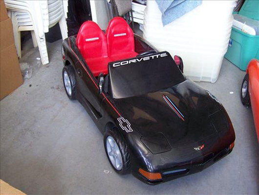 An electric motor powers this miniature Corvette. The toy sports car is 60 inches long and has a $400-$600 estimate. Image courtesy of Harrison Auctions Inc.