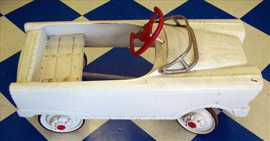 Basic transportation, this vintage pedal car is in its original white paint with red trim. It is expected to sell for $200-$400. Image courtesy of Harrison Auctions Inc.