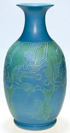 Rare and important, this 14 3/8-inch Overbeck vase is carved with the profiles of three women walking amid stylized flowers. The work of sisters Elizabeth and Mary Frances Overbeck, the vase is estimated at $12,000-$17,000. Image courtesy of the Auctions at Rookwood.