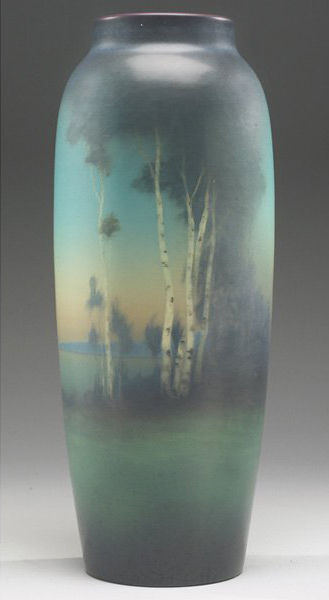 A finely painted landscape by Lenore Asbury is covered with a Vellum glaze. The 15-inch Rookwood vase, which is dated 1918, has a $3,500-$4,500 estimate. Image courtesy of Treadway Gallery.