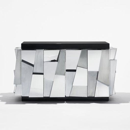 Veneered in large facets, this cabinet in chrome-plated steel brought $35,000 in the March 24, 2009 sale at Wright. Image courtesy of Wright.