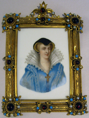 An 18th-century portrait of Mary Queen of Scots is painted on porcelain and presented in its original brass and jeweled frame with simulated pearls, turquoise and garnets. The 4-inch by 5 1/2-inch painting has a $400-$800 estimate. Image courtesy of Professional Appraisers and Liquidators LLC Antique Auctions.